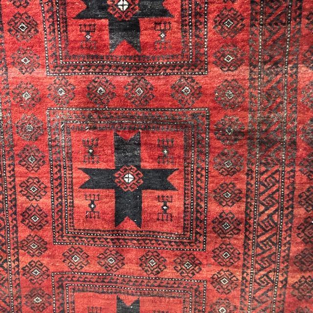 Lot 1064 - AN AFGHAN BOKHARA RUG