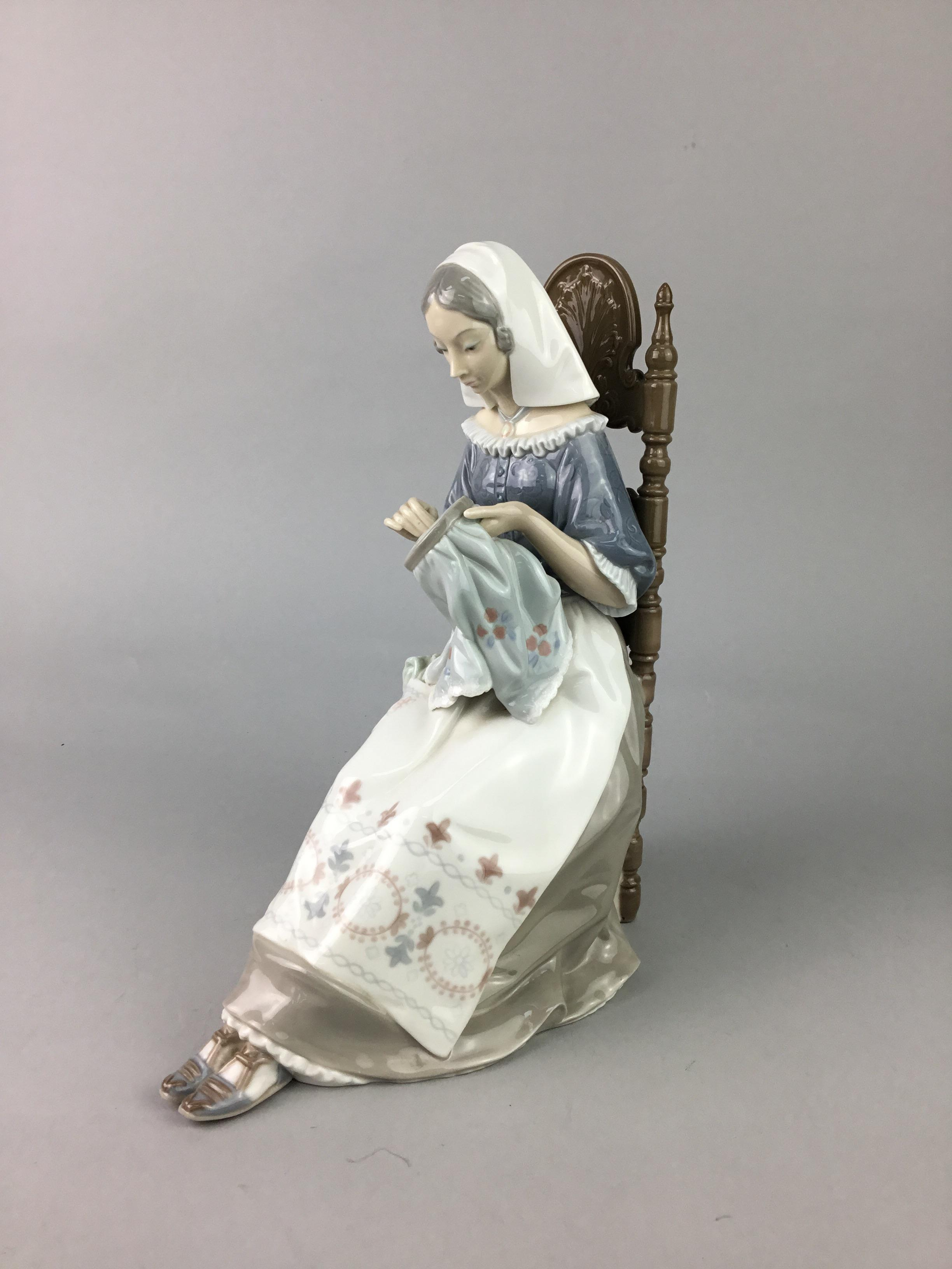 Lot 127 - A LLADRO FIGURE OF AN EMBROIDERER