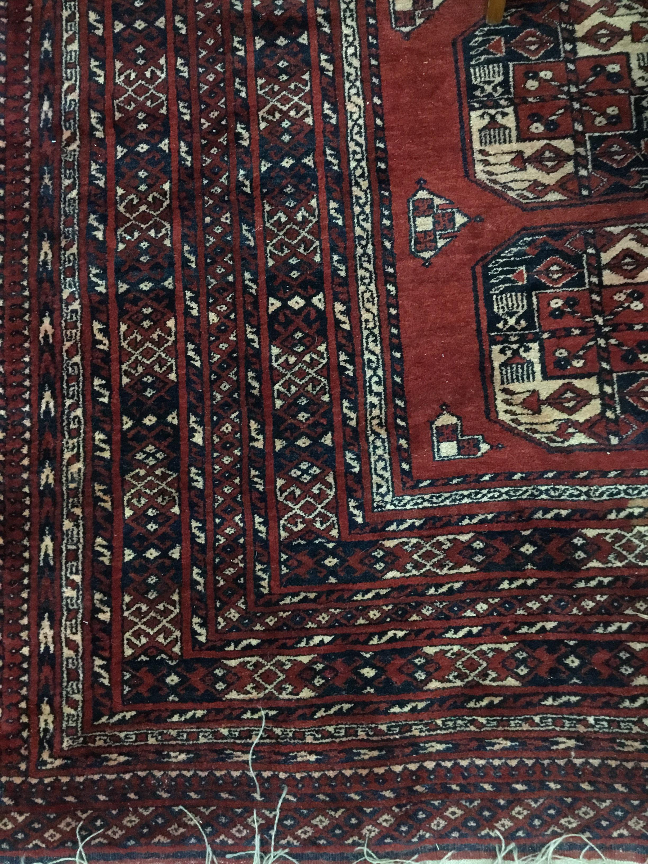 Lot 255 - A 20TH CENTURY EASTERN FRINGED AND MULTI BORDERED CARPET