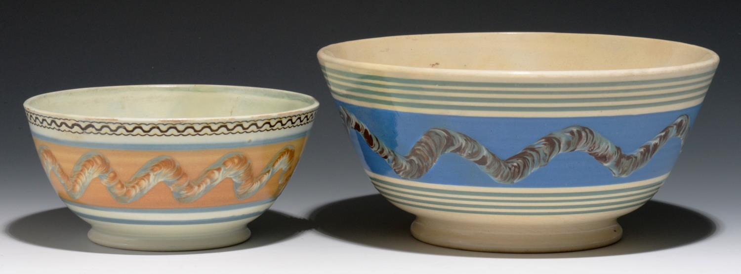 Lot 297 - TWO MOCHA WARE BOWLS, MID 19TH Cdecorated with a multichambered slip pot with bands of cat's