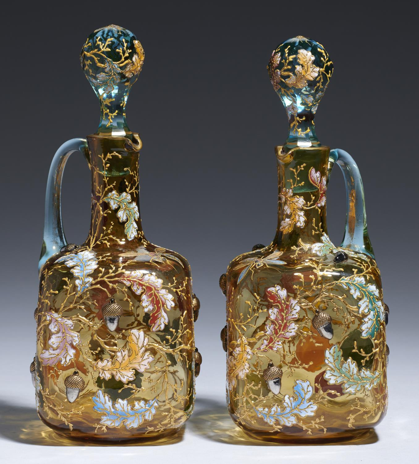 Lot 369A - A PAIR OF MOSER ENAMELLED AMBER AND KINGFISHER BLUE GLASS DECANTERS AND STOPPERS, C1900  applied