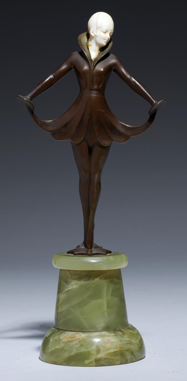 Lot 221 - AN ART DECO BRONZE AND IVORY STATUETTE, C1930 turned onyx plinth, 23cm h Hairline cracks in ivory