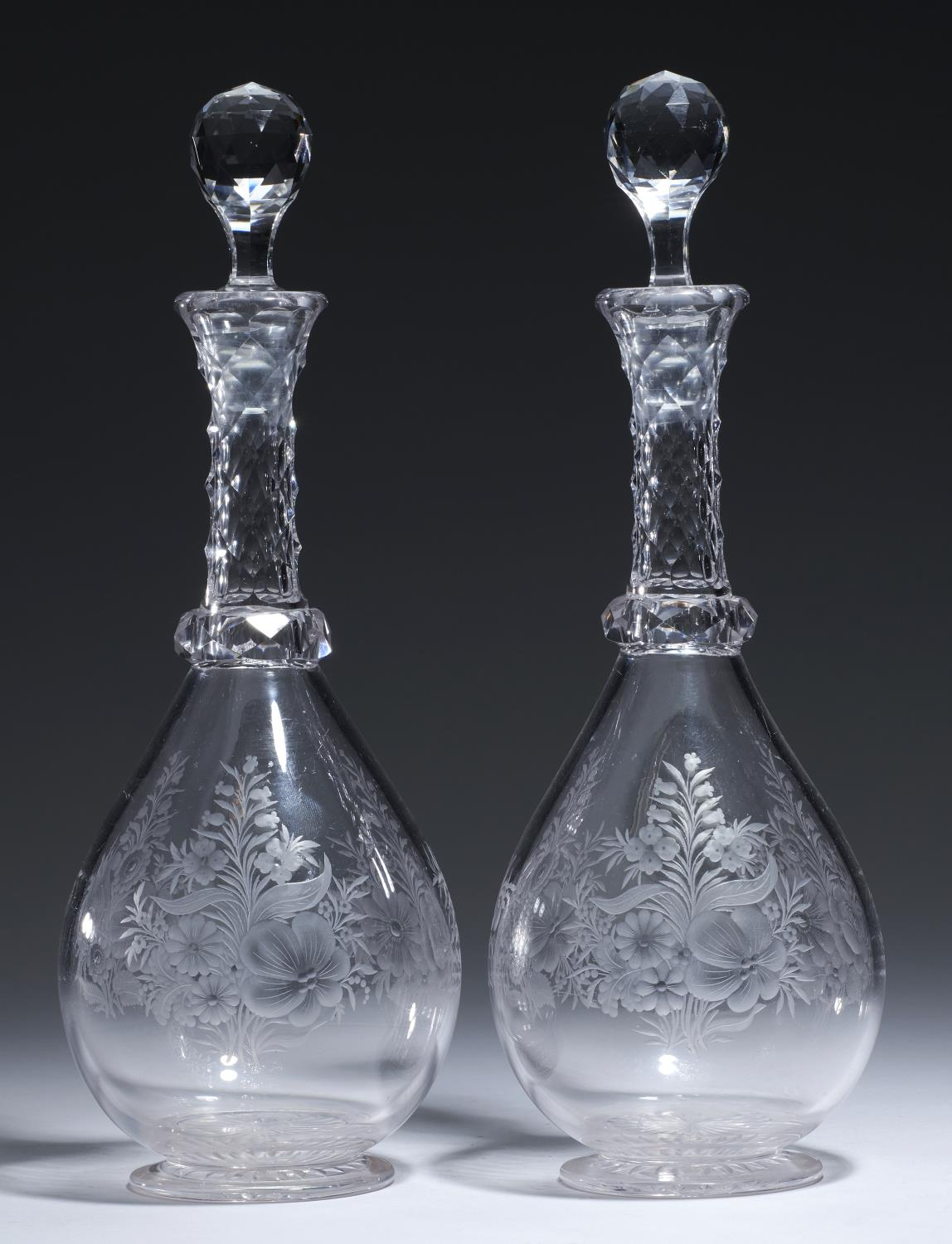 Lot 371 - A PAIR OF ENGRAVED AND CUT GLASS DECANTERS AND STOPPERS, EARLY 20TH C with faceted neck and