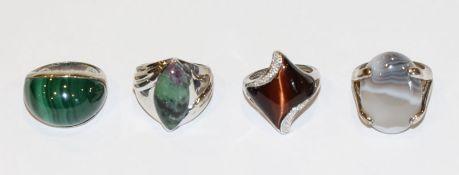 4 Sterlingsilber Ringe mit Farbsteinen, u.a. Malachit, Tigerauge u. a., Gr. 57