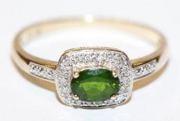 14 k Gelbgold Ring mit Smaragd und in Weißgold gefaßten Diamanten, 3,3 gr., Gr. 66