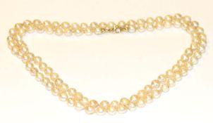 Perlenkette mit 14 k Gelbgold Schließe, L 84 cm, Tragespuren