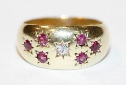 14 k Gelbgold Ring mit 6 Rubinen und einem Diamanten, 8,7 gr., Gr. 56