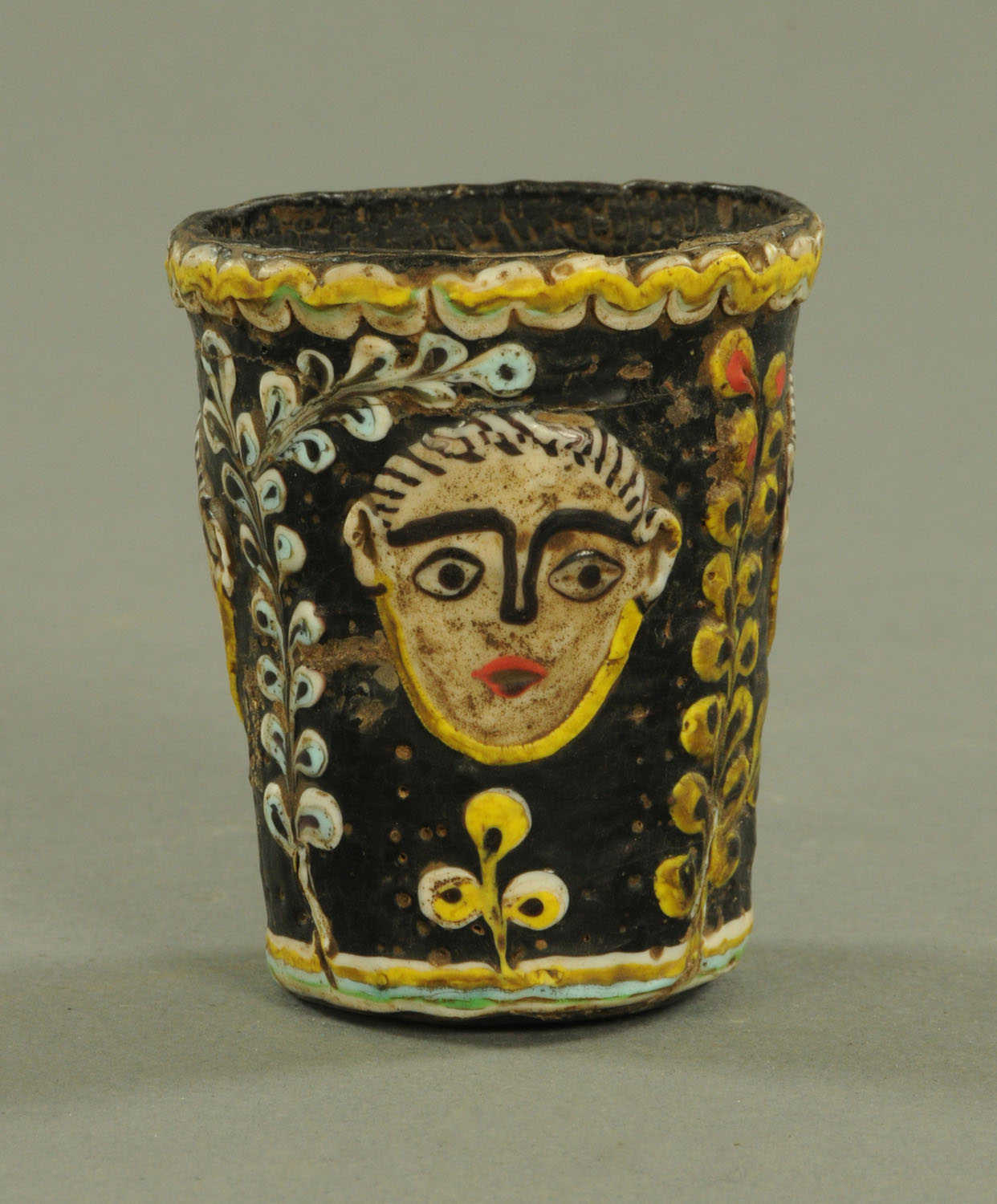 Lot 1004 - A Phoenician glass tumbler, second century BC-6th century AD,