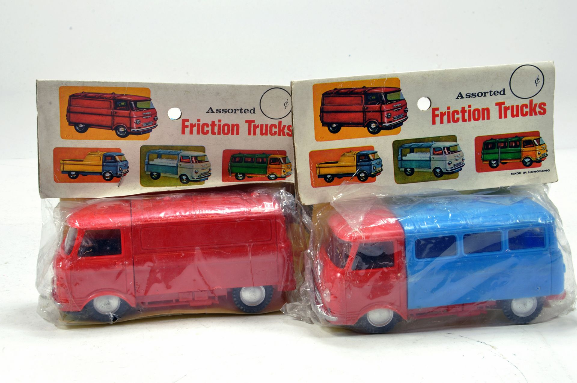 Lot 1432 - Duo of plastic Empire Made Friction Trucks in carded bags. E to NM.