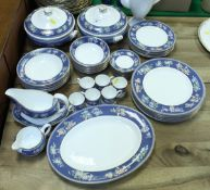 """A Wedgwood """"Blue Siam"""" coffee and dinner service of six place settings to include coffee pot,"""