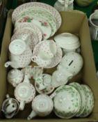 A box containing various chinawares including Nina Campbell loveheart decorated tea wares,
