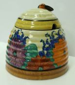 """A Clarice Cliff """"Bizarre"""" """"Spring Crocus"""" honey pot and cover,"""