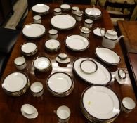 """A Richard Ginori """"Sardinia"""" pattern royal blue and gilt banded dinner service (approx 72 pieces)"""