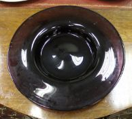 A large amethyst glass charger in the Murano manner