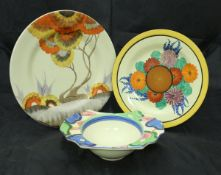 """A Clarice Cliff """"Bizarre"""" grapefruit dish, together with a Celtic harvest jug,"""