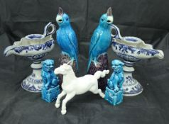 A pair of Continental tin glazed pottery blue and white chamber sticks,