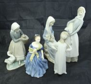 Four various Lladro figures,
