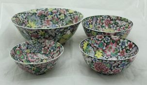 A set of four graduated Republic era Chinese millefleurs bowls with wooden stands