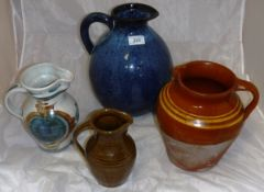 A collection of six various studio pottery and other jugs,