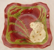 A Minton secessionist square dish decorated with a wild rose on a red ground and a glass