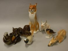 """A collection of Lomonosov porcelain animals including """"Seated Cat"""", """"Dog"""", """"Bear"""", """"Fawn"""","""