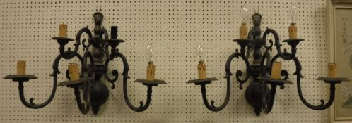 A pair of 20th Century brass five branch wall sconces in the 17th Century Dutch manner