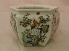 A 19th Century Chinese Kangxi palette polychrome decorated jardiniere of hexagonal form each panel