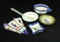 A large quantity of various Quimper pottery and other faience wares including bowls, small plates,