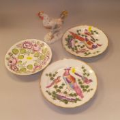 A pair of Sampson porcelain plates decorated with exotic birds, a Sampson figure of a chicken,