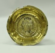 A 17th Century Nuremberg brass bowl the centrefield decorated with Adam and Eve with the serpent