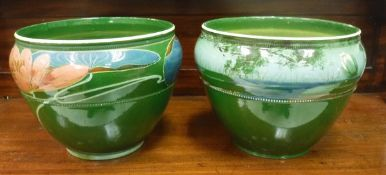 Two Art Nouveau green glazed pottery jardinieres decorated by Ronald Dean,