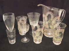 An early 20th Century glass lemonade set with enamelled floral decoration (poss Lily of the Valley),