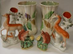 A collection of Staffordshire pottery to include a pair of stag spill vases,
