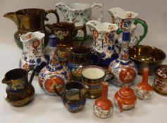 A set of three Allertons Japan pattern hydra jugs with serpent handles,
