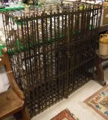 A vintage wrought iron wine cage, the two slatted doors enclosing 144 bottle rack,