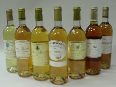 A collection of sixteen various bottles dessert / pudding wines including Chateau Raymond-Lafon