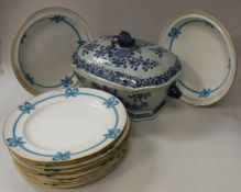 A 19th Century Chinese blue and white tureen and cover with all-over floral decoration,