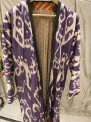 An Uzbekistan Chapan of purple colour Ikat CONDITION REPORTS Fading and