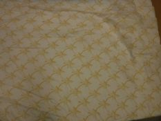 A pair of woven linen type oatmeal ground curtains, interlined,