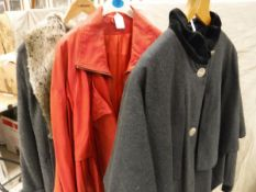 A collection of clothing to include an Emporio Armani suede jacket together with a red leather coat,