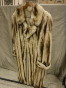 A cream and brown full length fur coat with sateen lining initialled BGH also KCH,