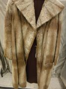 A white otter fur coat, full-length,