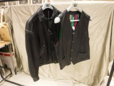 A V2 by Versace black leather jacket, together with a matching waistcoat with striped silk lining,