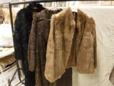A pale brown rabbit fur jacket, size 12,