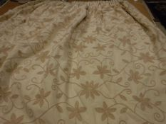 A pair of cotton type cream ground crewel work style decorated interlined curtains with tape,