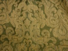 A pair of cotton green and gold foliate decorated curtains, interlined,