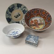 A collection of Oriental design pottery and porcelain to include three bowls,