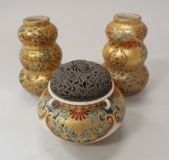A pair of Japanese Meiji period Satsuma ware gourd shaped miniature vases together with a similar