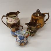 A collection of ten items of Victorian copper lustre ware and a Davenport hydra jug