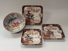A graduated set of three Japanese Imari square dishes decorated with birds amongst blossoming